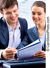 Two people - Portrait of young lady and business man looking...