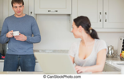 Two people relaxing in the kitchen