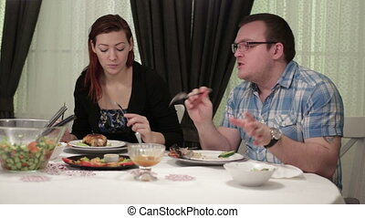 Two people sitting at the dinner table in a cafe
