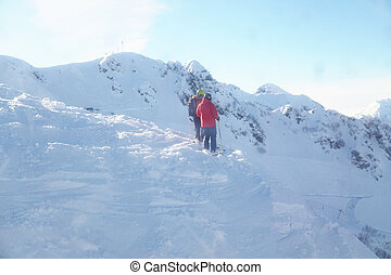 two people stand on a mountain ski resort