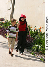 Two people strolling on a path - Two people walk along a...