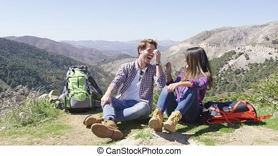 Two people taking rest while hiking - Two young people ...