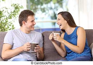 Two people talking and laughing at home