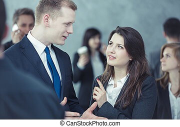 Two people talking in the crowd - People talking while...