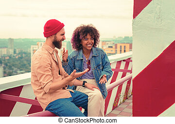 Two people using gestures and laughing at the funny joke