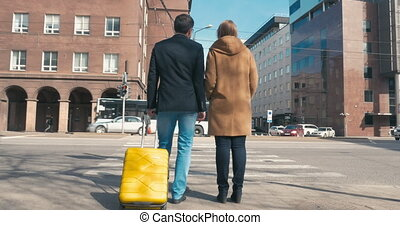 Two People Waiting for Green Traffic Light
