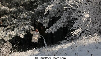 Two People Walking In The Woods - A man and woman emerge...