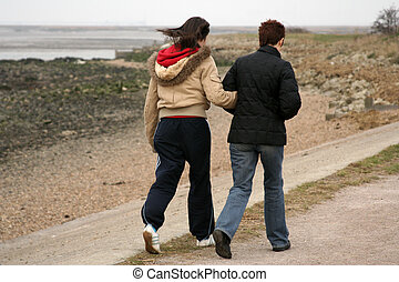 Two people walking - A couple walking together