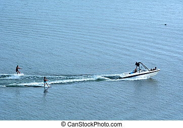 Two people water skiing