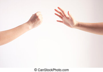 Two person playing rock paper scissors; one hand showing rock or hammer symbol and another hand showing paper symbol; concept of business competition.