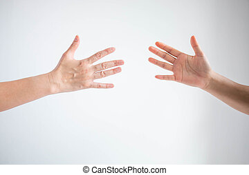 Two person playing rock paper scissors with both posturing paper symbol on white background.