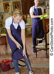 two persons cleaning a house