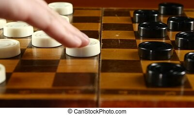 Two persons playing on checker board, slow motion, close up