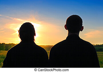 Two Persons Silhouette - Two Persons silhouette on sunset...