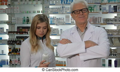 Two pharmacists pose at the drugstore