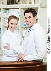 Two Pharmacy chemist workers in drugstore
