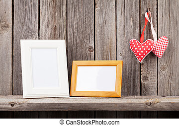 Two photo frames and Valentines day hearts