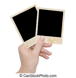 two photo frames in a hand
