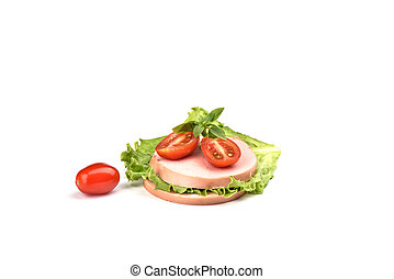 Two pieces of boiled sausage with sliced tomatoes and a leaf of lettuce on a white background. Traditional Russian sausage.