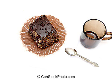 Two pieces of chocolate cake on plates,