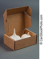 Two pieces of garlic in the box.