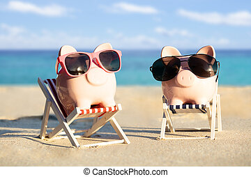 Two Piggybanks With Sunglasses On Deck Chairs At Beach