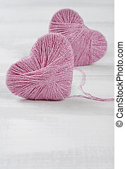 Two pink hearts - Two pink clews in shape of heart on white...