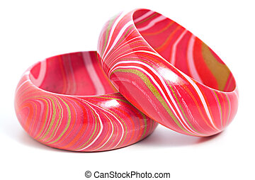 Two Pink Wooden Bangles on White Background