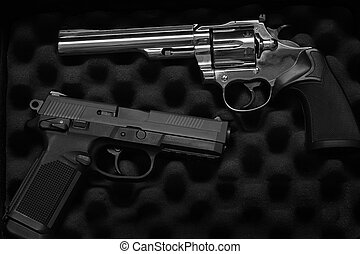Two Pistols Handguns for Self Defense or Military - Closeup...