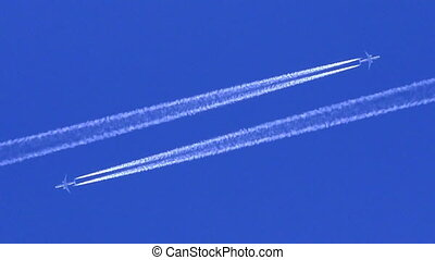 Two Plane traces - Two airplane with trail in the blue sky,...