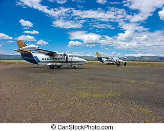 Two planes in a small local airport in Masai Mara national...