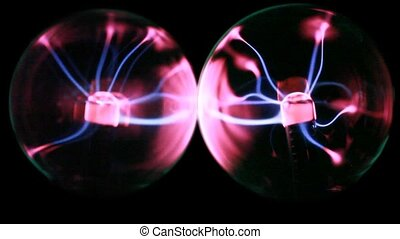 Two plasma balls stand close, energy lines move inside