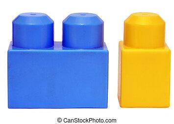 plastic blocks - two plastic blocks close up over white