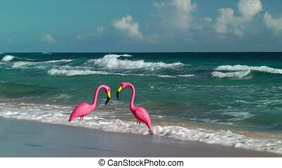 Two plastic flamingos on Isabel Beach in Puerto Rico