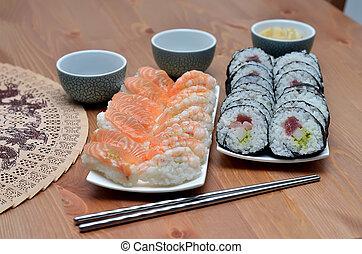 two plate of maki sushi rolls and nigiri sushi with salmon...
