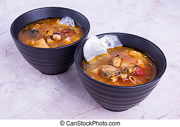Two plates of fish soup