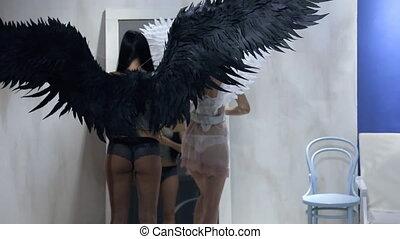 Two pleasant women correct underwear opposite to mirror, rear view.