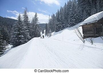 free ski run - two poeple on a free ski run in italy