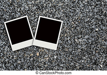 Two Polaroid on asphalt texture