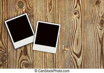 two Polaroid photo frames on wooden background