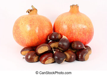 Two pomegranates and chestnuts