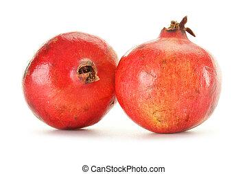 Two pomegranates isolated on white