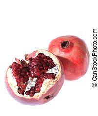 Two pomegranates over white background
