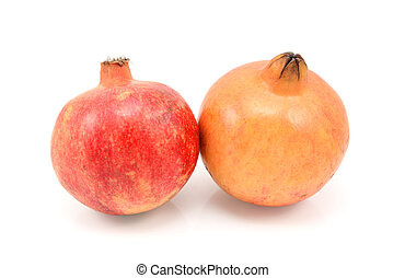 Two pomegranates, red and yellow
