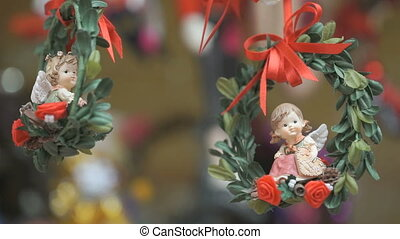 Two porcelain angels on red ribbons - Close-up - Christmas...