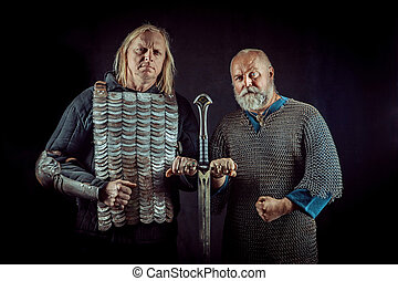 Two powerful knights are holding one sword.