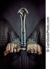 Two powerful knights are holding the hilt of one sword.