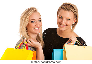 Two preety girls with shopping bags
