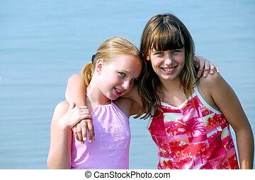 Two preteen girls - Portrait of two preteen girls standing...