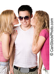 Two pretty blonde kissing young man - Two pretty blonde...